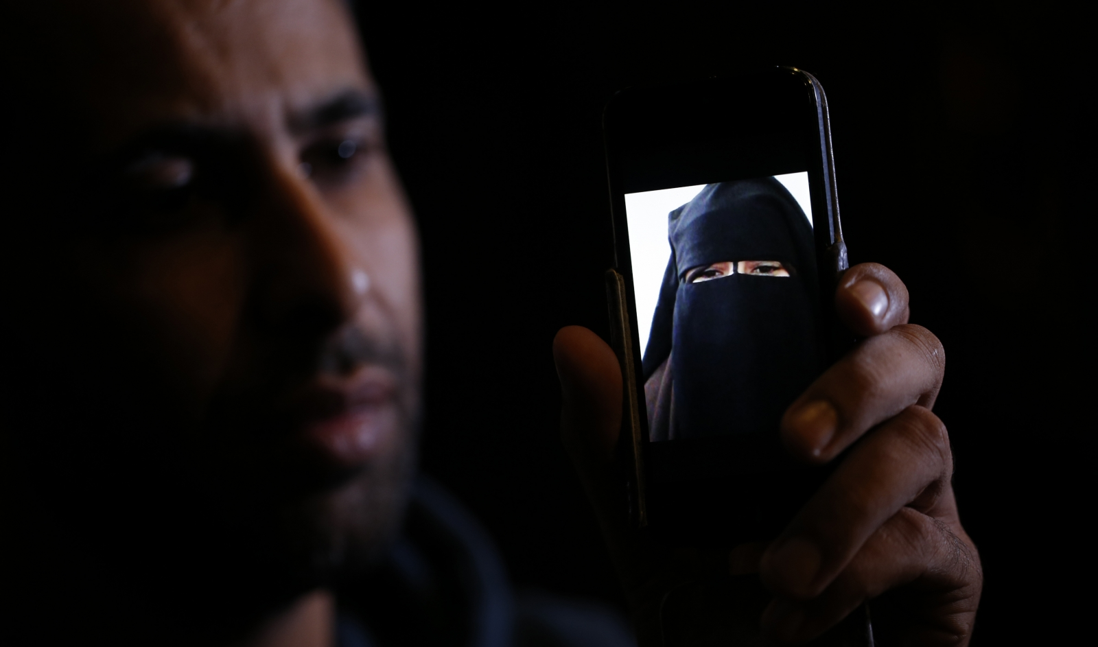 Foad Al-Bahty shows a picture his 15-year-old sister sent him from Syria after joining IS. (Reuters)