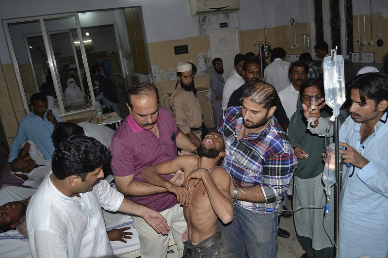 A wounded Imran Khan supporter is taken to hospital after the stampede in the Pakistan's central city of Multan, which killed at least seven and injured 42