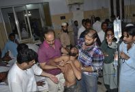 A wounded Imran Khan supporter is taken to hospital after the stampede in the Pakistan\'s central city of Multan, which killed at least seven and injured 42
