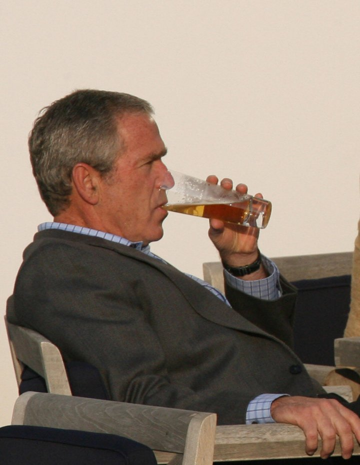 George W Bush sips a non-alcoholic beer in Germany in 2007.