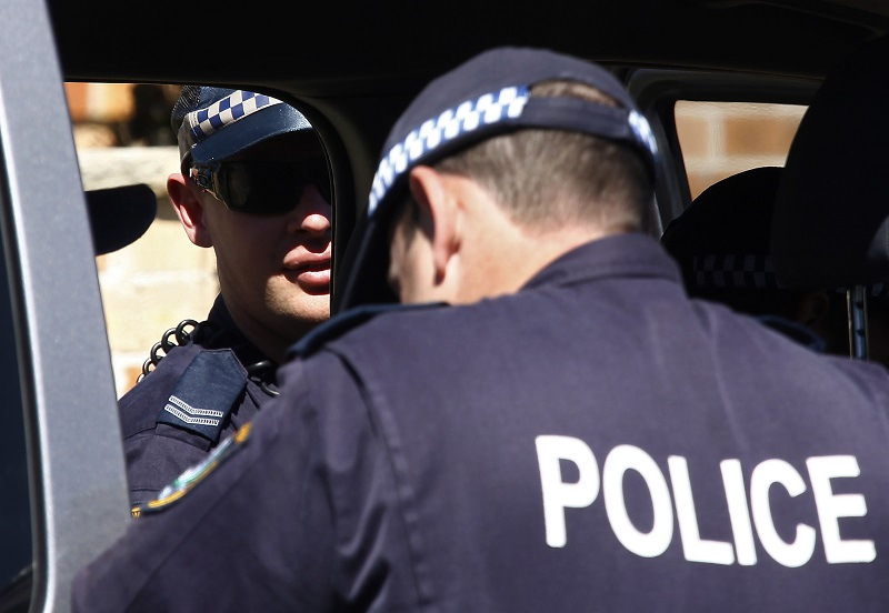 Brisbane police are questioning two males over the racist rant caught on video
