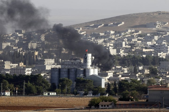 Smoke rises over Kobani during fighting between isis militants and Kurdish fighters last week. (Getty)
