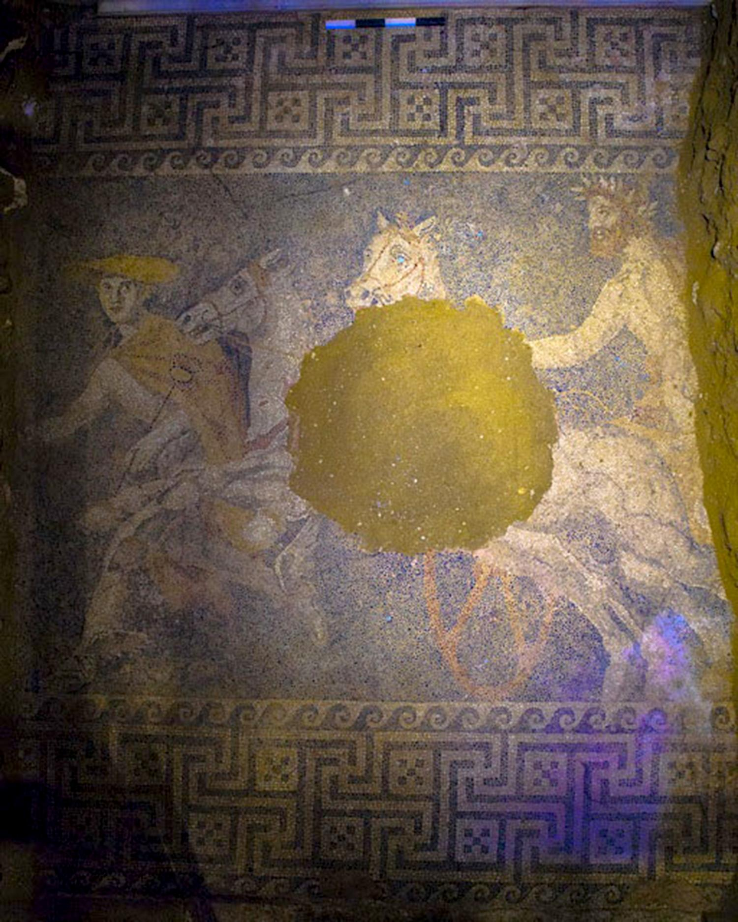 Blue mosaic floor of the Greek god Hermes leading a chariot bearing an unknown man