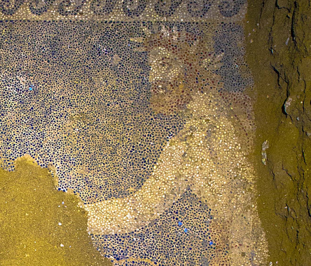 An unknown bearded man who wears the laurel wreath of a king or god in the mosaic
