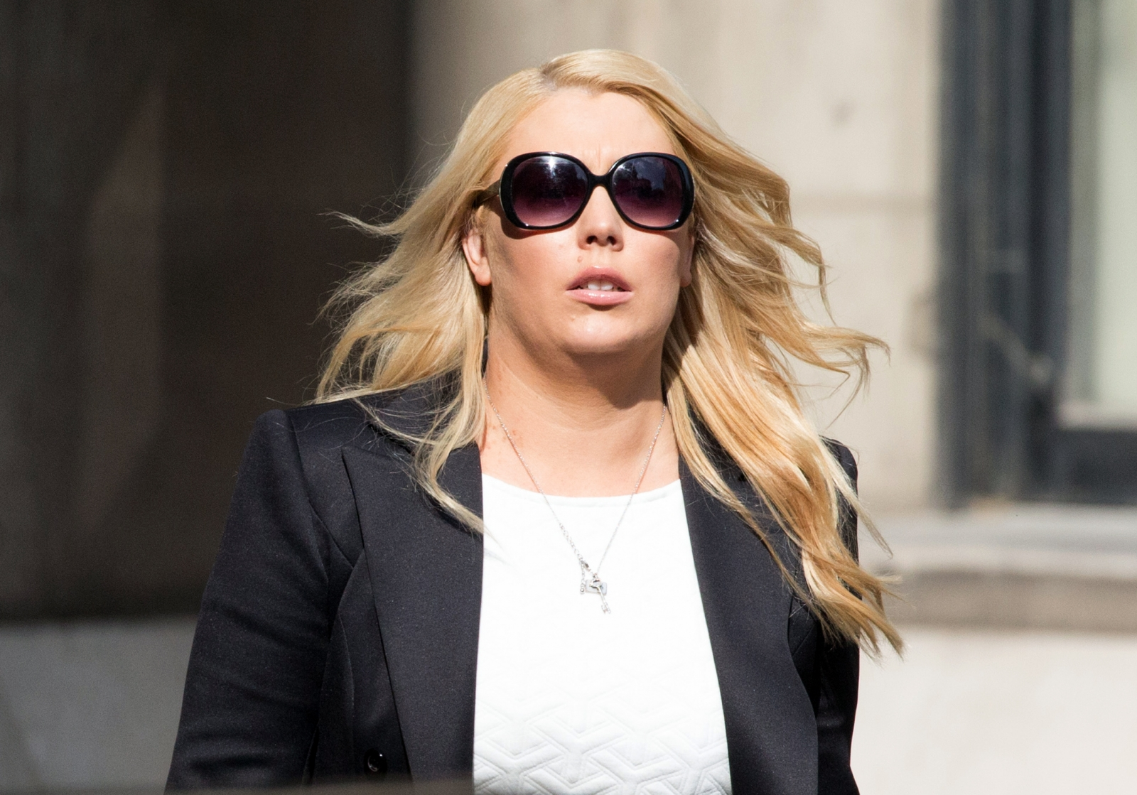 Australian DJ Mel Greig leaves the High Court in London