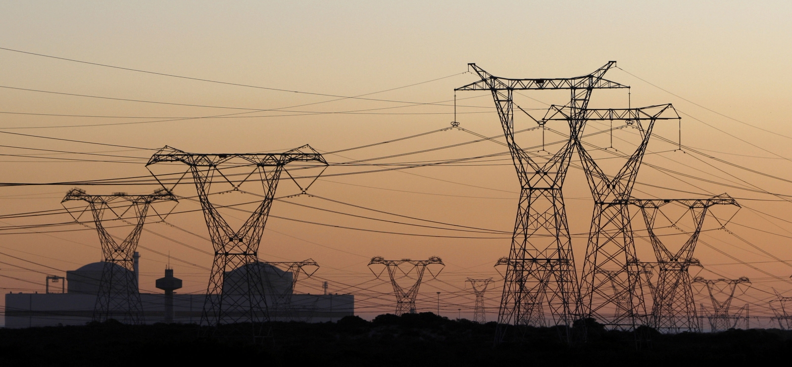 Electricity pylons carry power from Cape Town\'s Koeberg nuclear power plant
