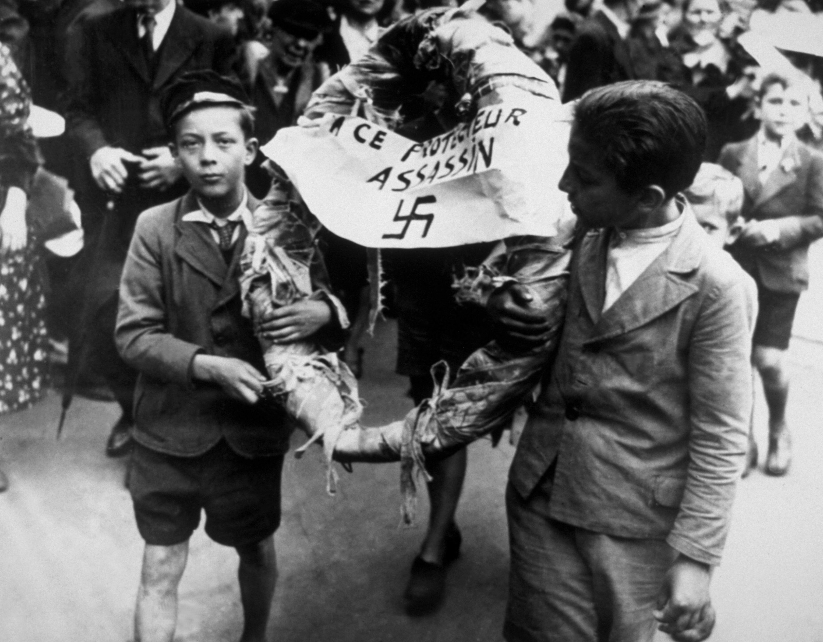 Young citizens of Brussels in Belgium lay in wreath for Nazi following liberation