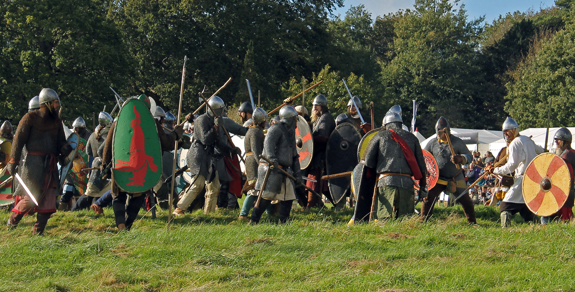 The Norman army fights the Anglo-Saxons at the Battle of Hastings 2014 re-enactment