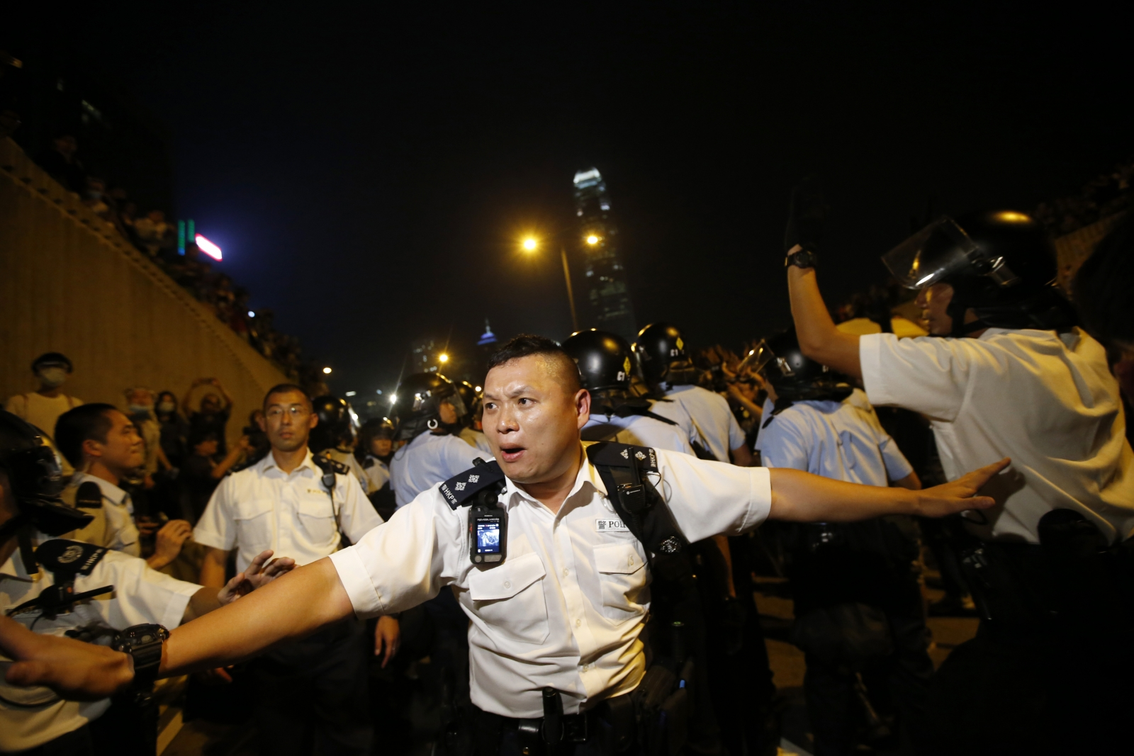 Police officers wielding pepper spray tore down barricades and concrete slabs built up by pro-democracy demonstrators