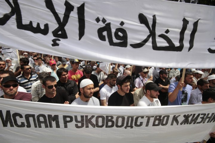 Supporters of the Islamist Hizb ut-Tahrir movement attend a rally in Simferopol, the administrative centre of Crimea in southern Ukraine