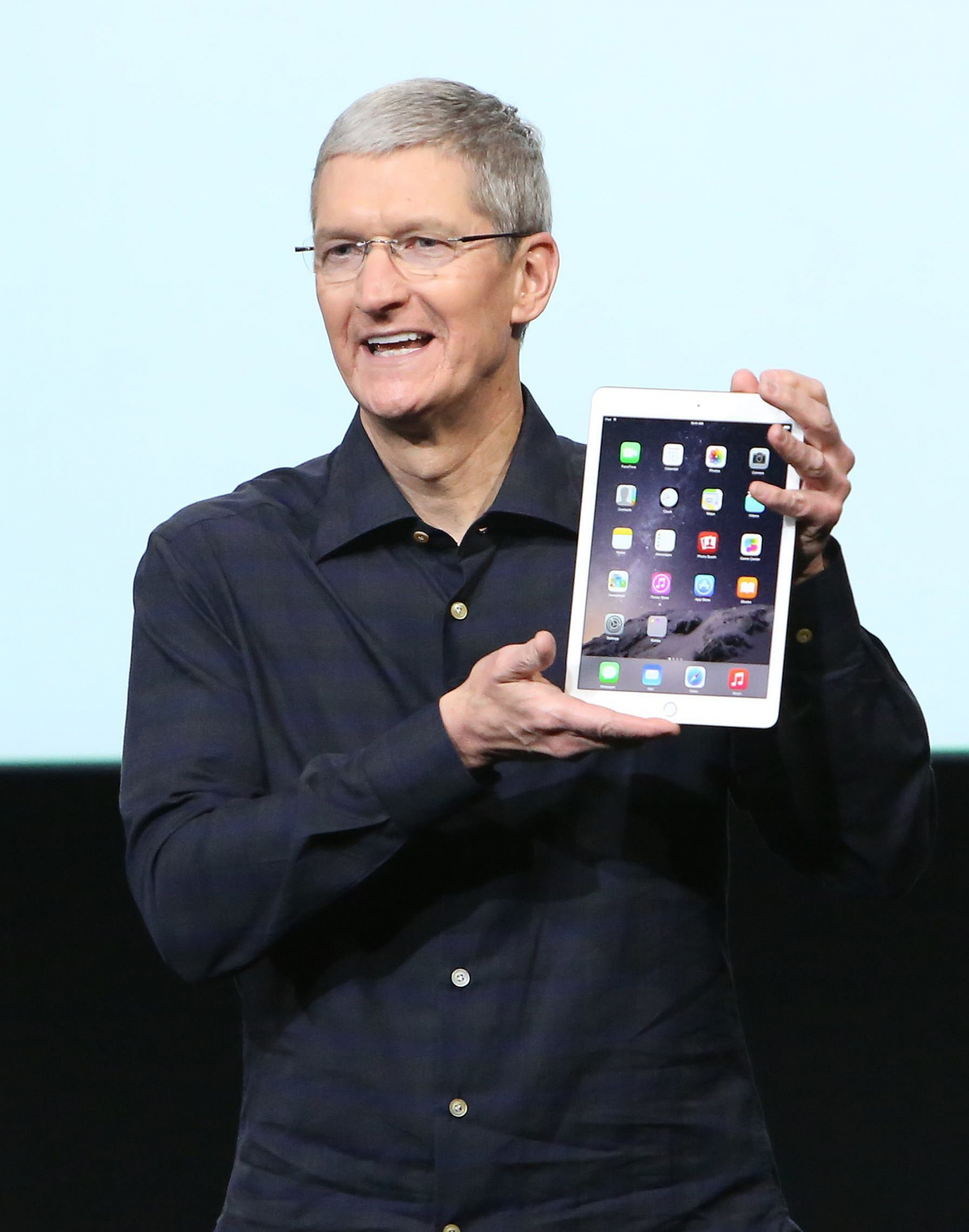 Apple CEO Tim Cook holds an iPad Air 2 during a presentation at Apple headquarters in Cupertino, California October 16, 2014