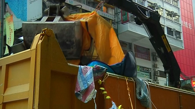 Hong Kong: Traffic Returns as Police Clear Protest Barricades