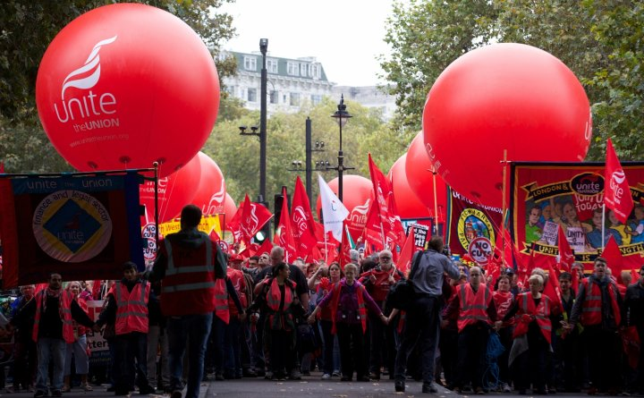 Protesters march through central London today, demanding pay hikes for public sector workers. (Getty)