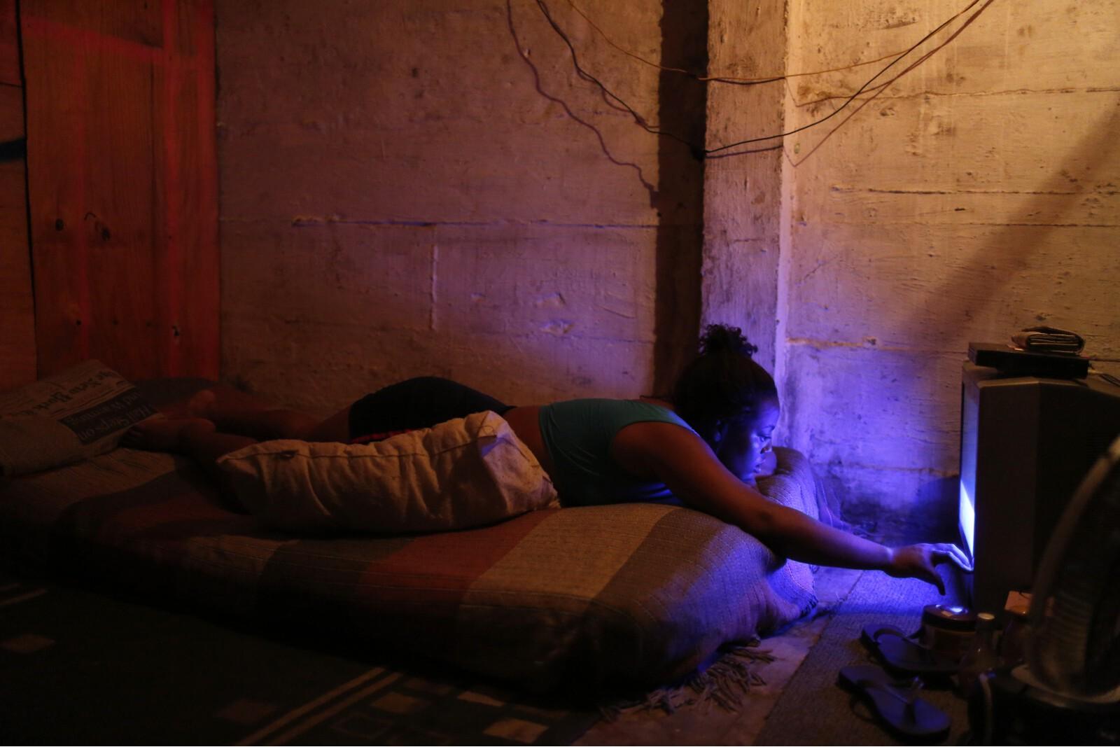 Brazil Factory Slum Woman Watching Television