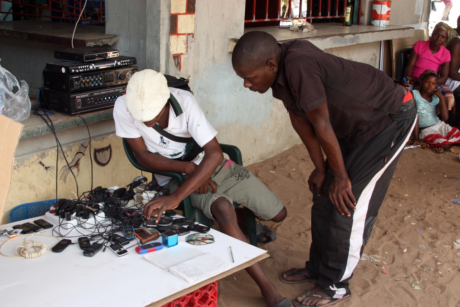 A street vendor sells mobile phones in Mozambique.