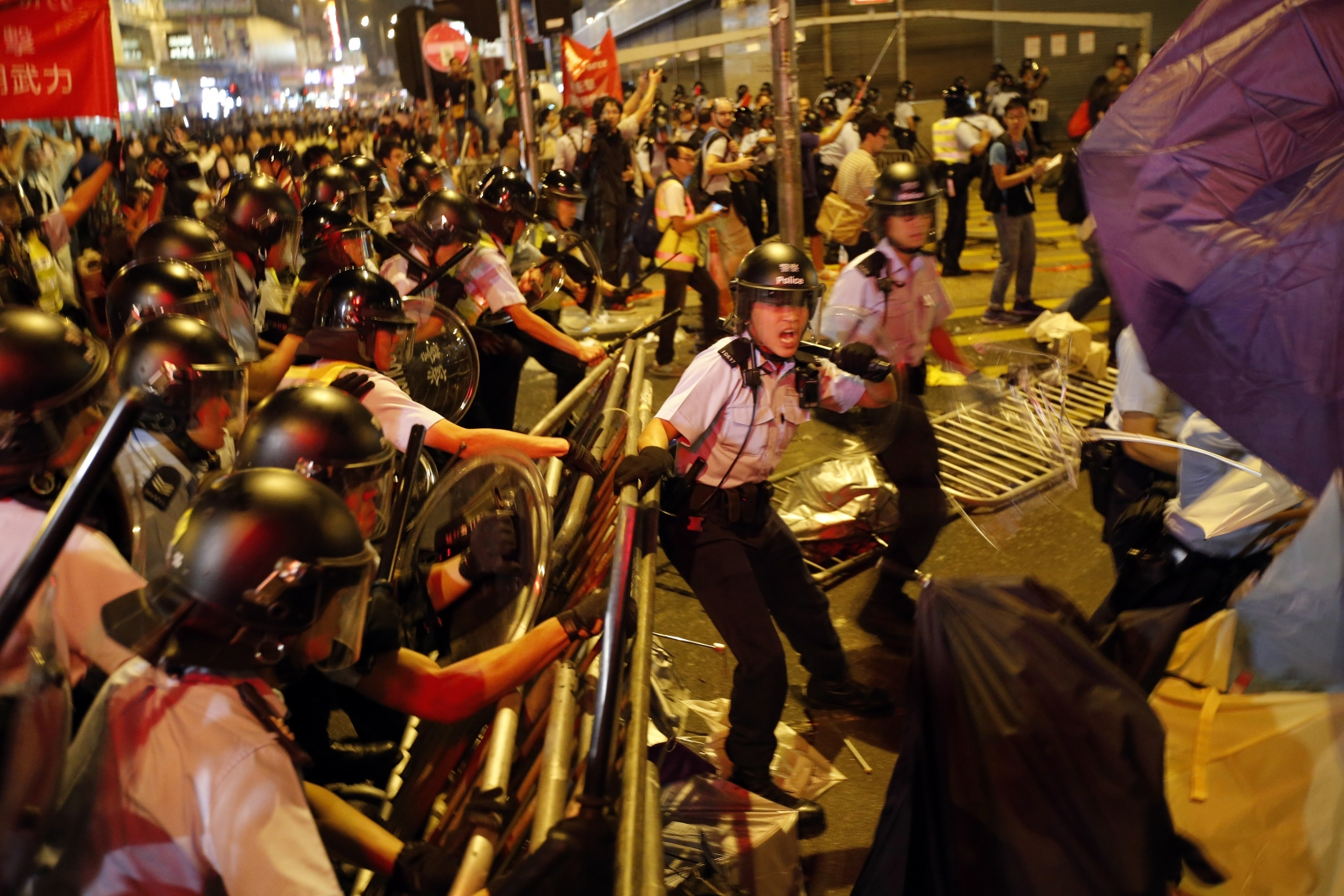Riot police move into a protest site during clashes with pro-democracy protesters at the Mongkok  district of Hong Kong