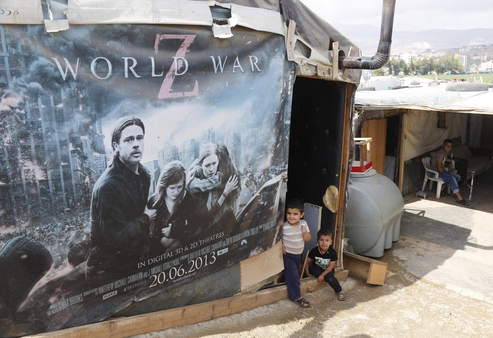 Syrian refugees in Lebanon in a shelter made from a Hollywood movie poster. (Reuters)