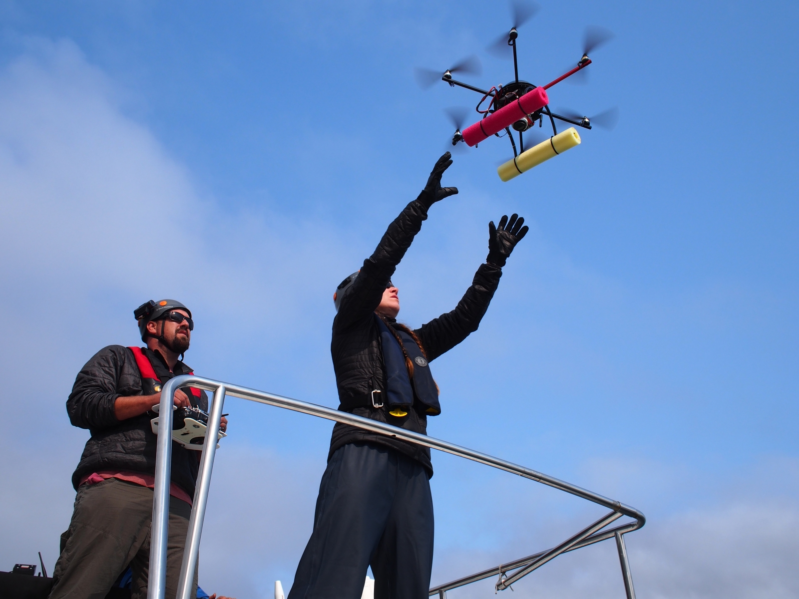 Researchers John Durban and Holly Fearnbach launch the Mobly drone from the roof of the Skana boat