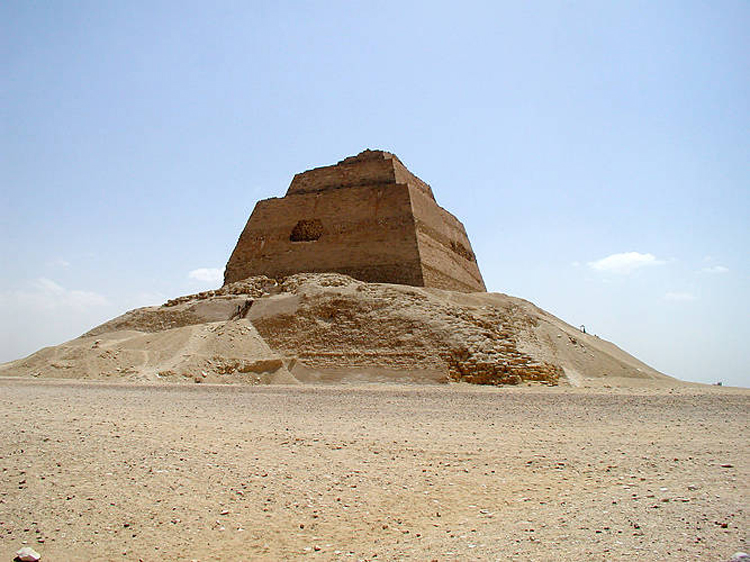 The Meidum Pyramid in Beni Suef - a crumbling step pyramid built by a successor of the master builder Imhotep