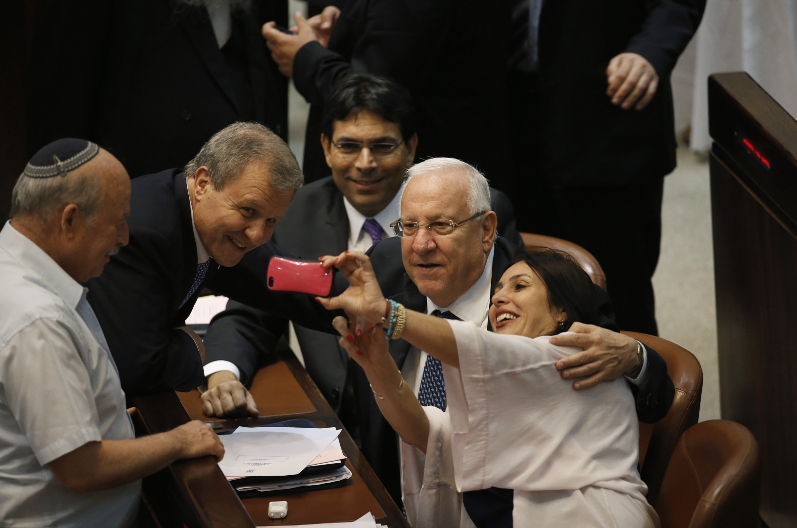 Israeli lawmaker Miri Regev (R) takes a selfie with presidential candidates, former Speaker of Parliament Reuven Rivlin (2nd R) and former Finance Minister Meir Sheetrit (2nd L)