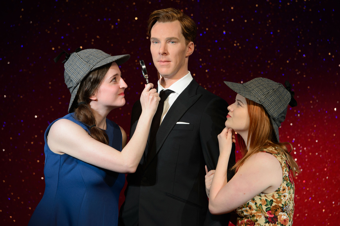 Two lucky fans who won a competition to attend a private viewing of the Benedict Cumberbatch wax figure don Sherlock Holmes' signature deerstalker hat