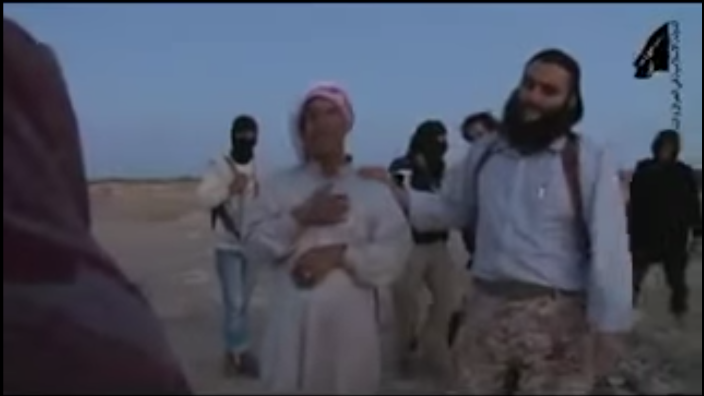 Still picture from graphic video showing woman stoned by death for adultery