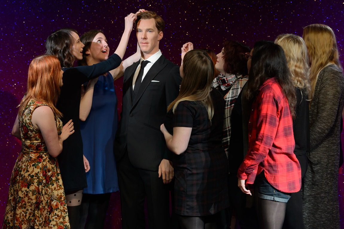 Benedict Cumberbatch fans touch the wax figure's hair reverently