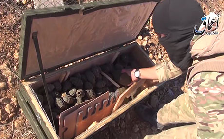 Still picture from pro-Isis video showing airdropped US military aid in the hands of Isis