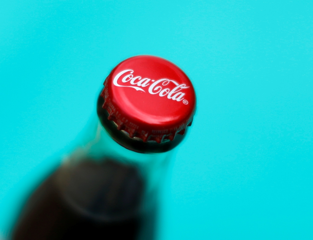 Coke's Profit Falls Prompting Firm to Expand Cost-Cutting Drive