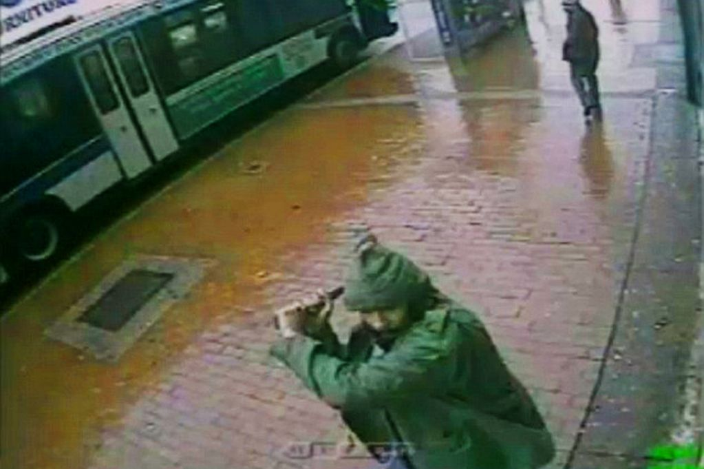 Still from CCTV footage allegedly showing Zale Thompson attacking NYPD officers with an axe (Handout)