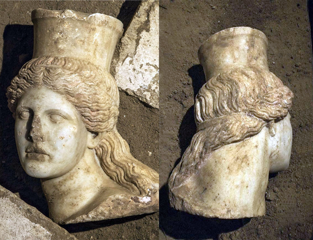 The sphinx head was discovered under some fallen slabs of stone in the fourth chamber. It has long curling hair with traces of red paint