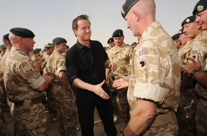 Britain's Prime Minister David Cameron speaks to British forces at Camp Bastion in Helmand Province