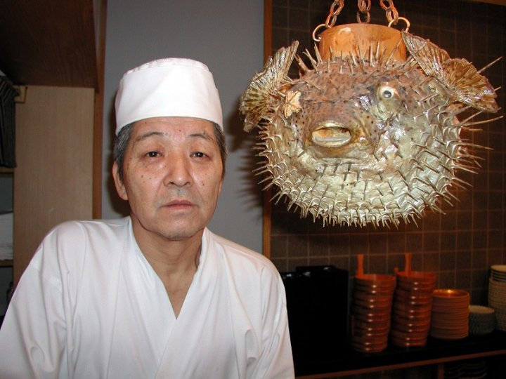 Sushi chef Juntaro Takagi poses with a pufferfish or 'fugu' at Japanese restaurant Chikubu. Pufferfish is considered a rare delicacy in Japan