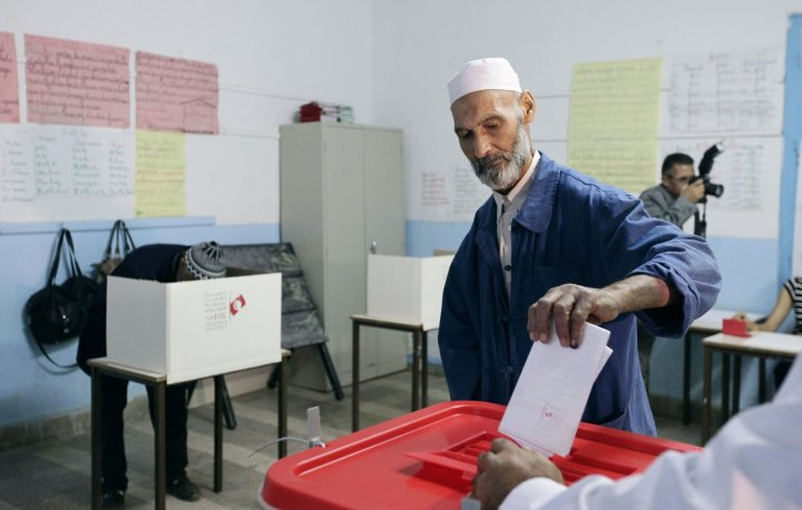 A man casts his vote at a polling station in Tunis October 26, 2014. Tunisians elect a new parliament on Sunday as the prospect of a full democracy finally comes within their reach, four years after they cast out autocrat Zine El-Abidine Ben Al