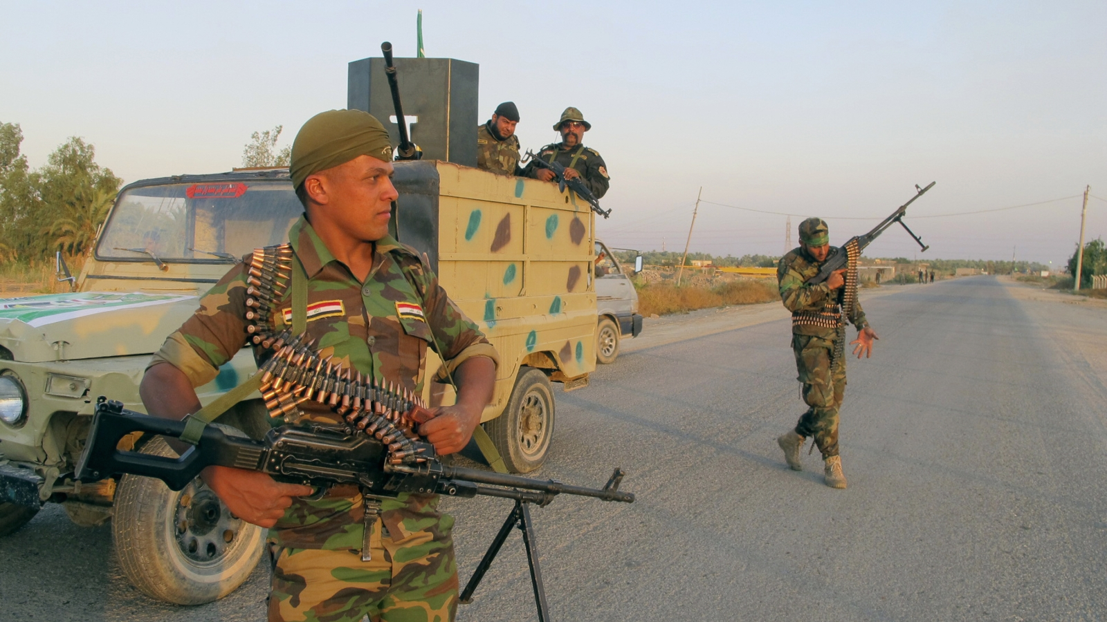Shi'ite fighters participate in an intensive security deployment against Islamic State militants in Jurf al-Sakhar