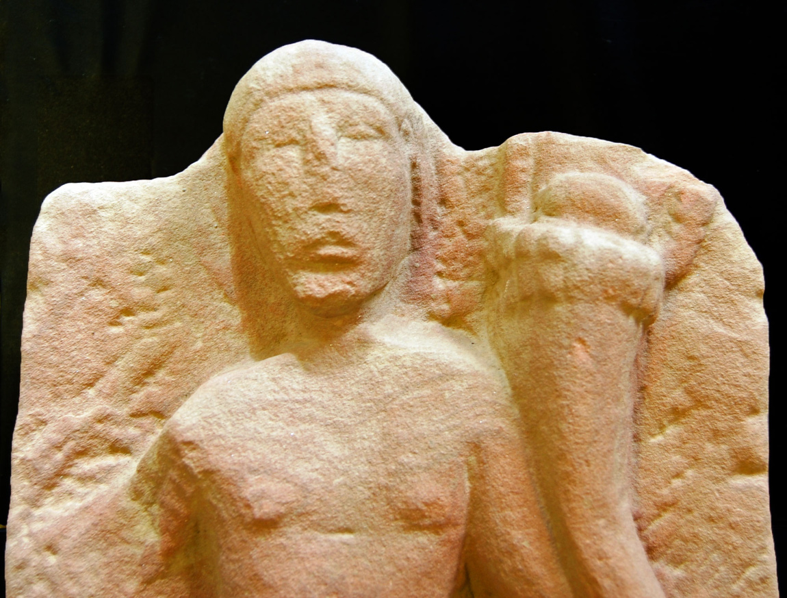 Close-up of the Genius Loci fertility deity statue