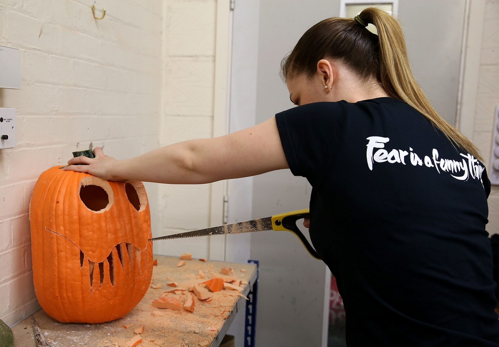 A pumpkin being carved by a London Dungeons employee to decorate the attraction for Halloween