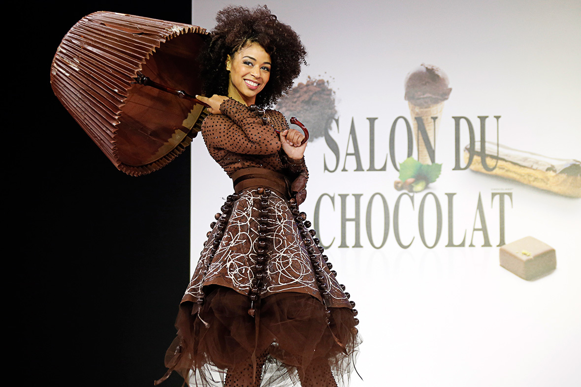Singer Aurelie Konate wears a chocolate costume made by fashion brand Feraud and chocolate maker Patric Chapon