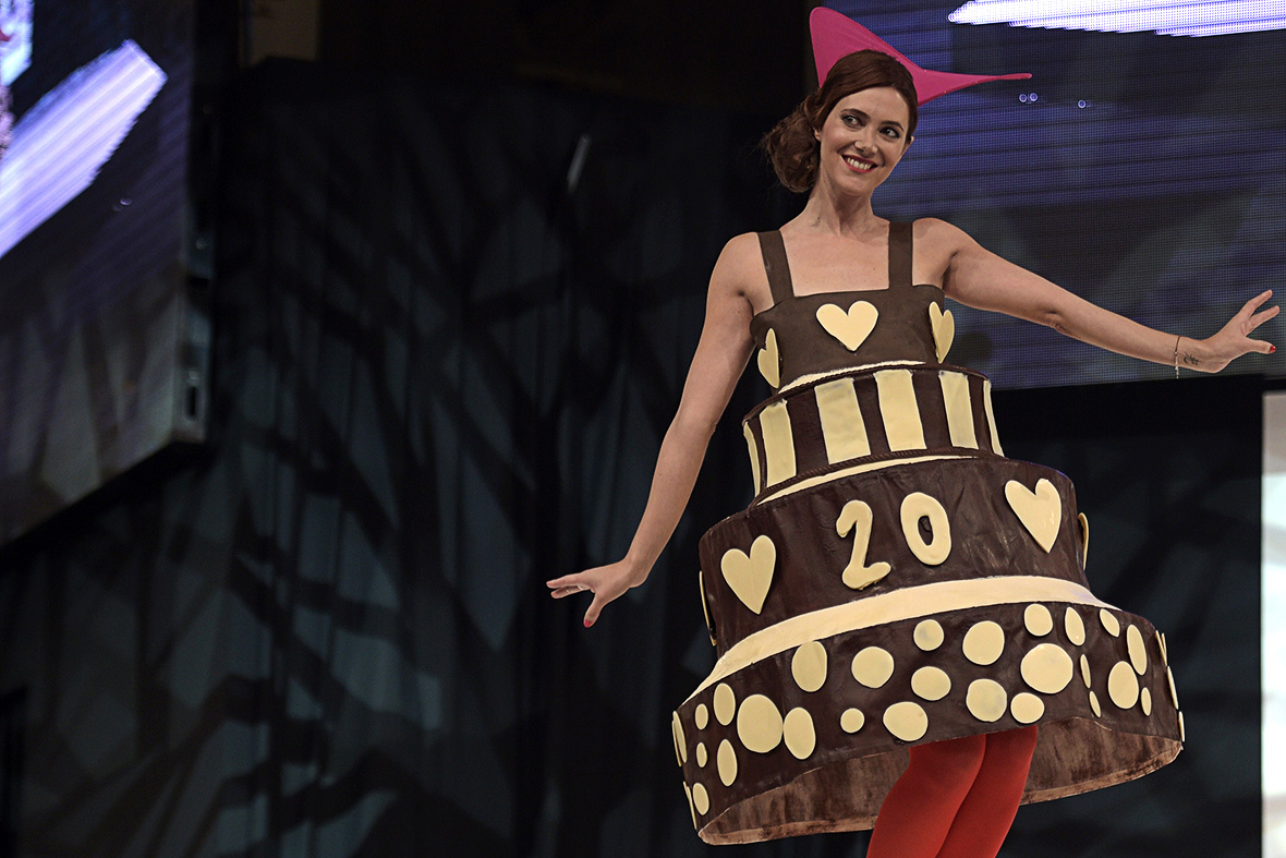 French TV presenter  Sandra Lou walks the runway wearing a chocolate dress made by designer Agatha Ruiz de la Prada and chocolate maker Joel Patouillard