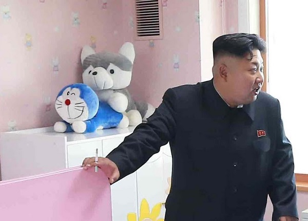 Two soft toys appearing to strike sex pose behind Kim Jong-un have amused the web