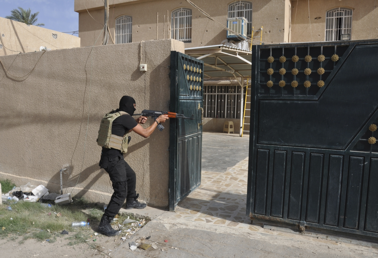 A member of the Iraqi security forces battles Isis militants in Ramadi, al Anbar province (Reuters)