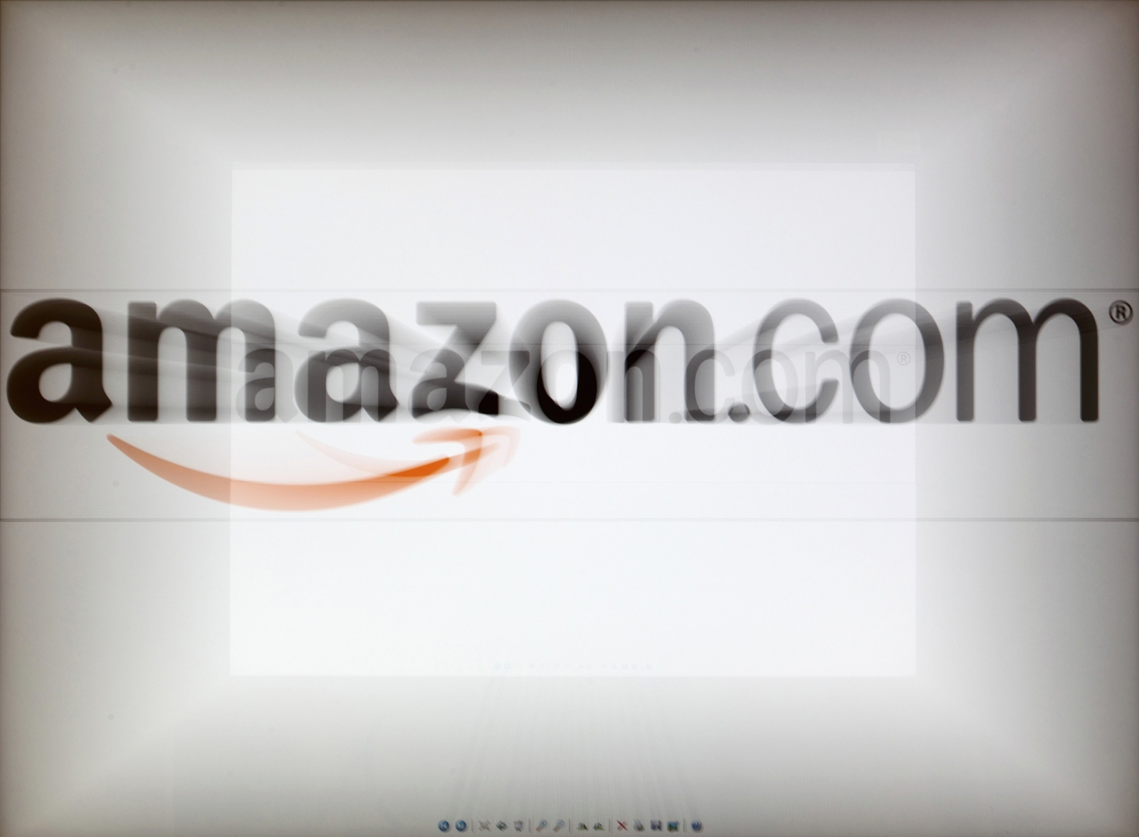 A zoomed image of a computer screen showing the Amazon logo