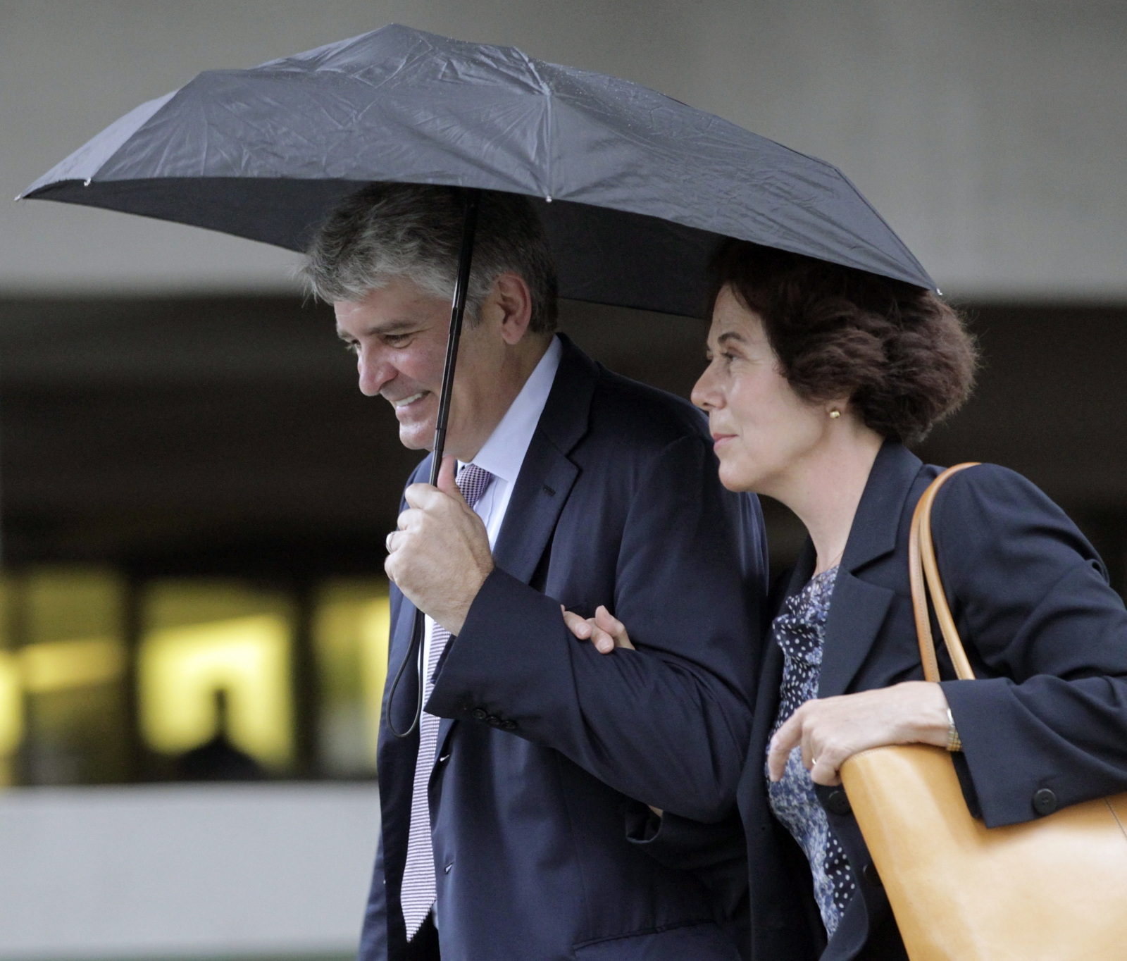 Former UBS banker Raoul Weil, accompanied by his wife Susan Lerch Weil, arrives at federal court in Fort Lauderdale, Florida