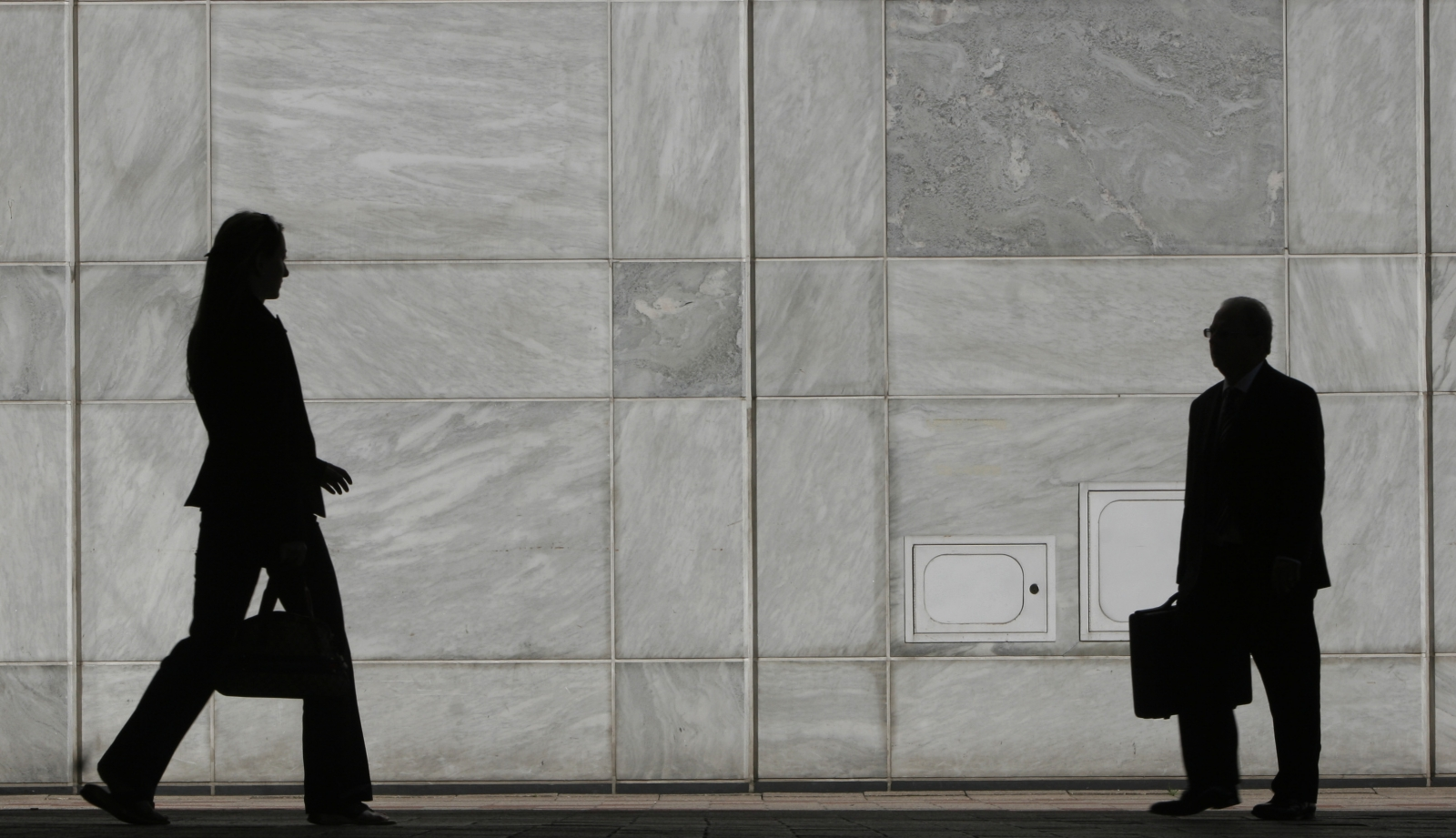 Woman walks in Canary Wharf
