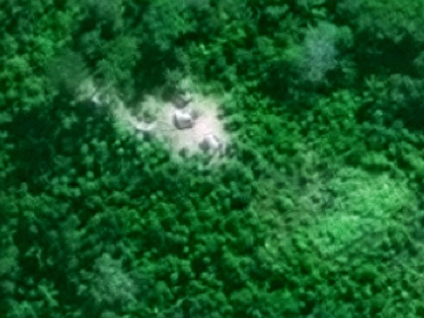 An isolated indigenous maloca (longhouse) in the middle of the rainforest found using satellite imagery