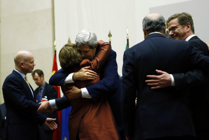 U.S. Secretary of State John Kerry (3rd R) hugs European Union foreign policy chief Catherine Ashton after she delivered a statement during a ceremony next to British Foreign Secretary William Hague (L), Germany's Foreign Minister Guido Westerwelle (R) a