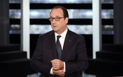 Frances President Francois Hollande poses before appearing on TF1 television prime time news live broadcast at their studios in Aubervilliers, near Paris, November 6, 2014