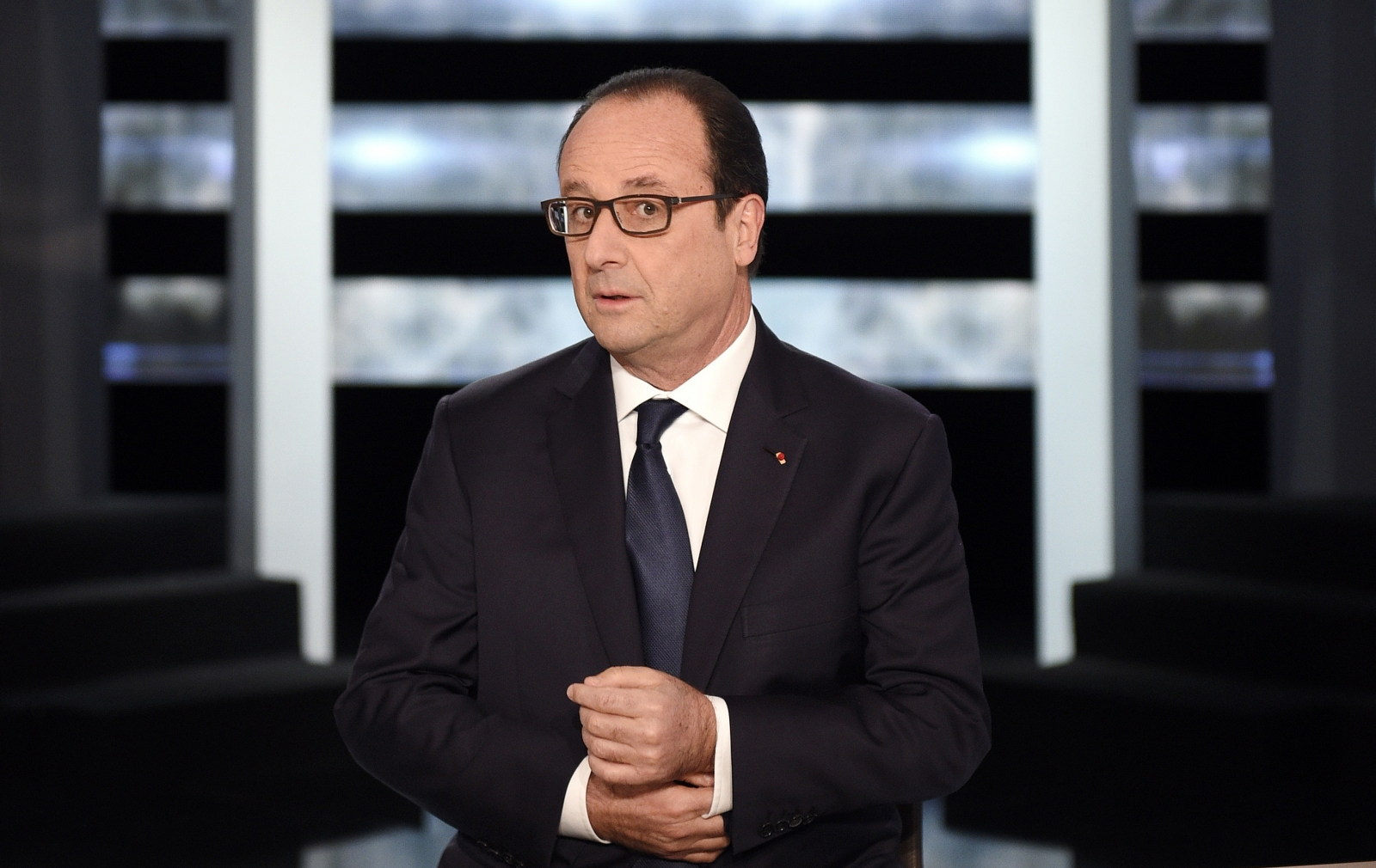 France's President Francois Hollande poses before appearing on TF1 television prime time news live broadcast at their studios in Aubervilliers, near Paris, November 6, 2014