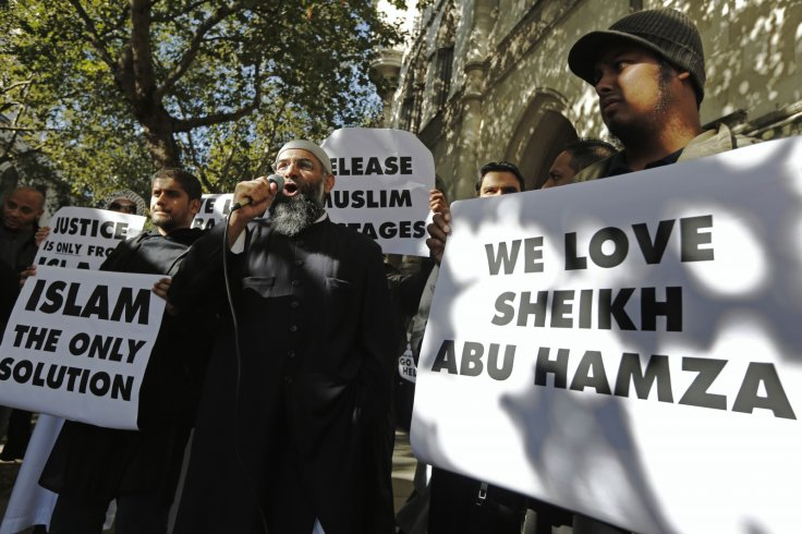 Protester Anjem Choudary (C), speaks into a microphone during a demonstration in support of Islamist cleric Abu Hamza al-Masri, who is appealing against his extradition to the U.S