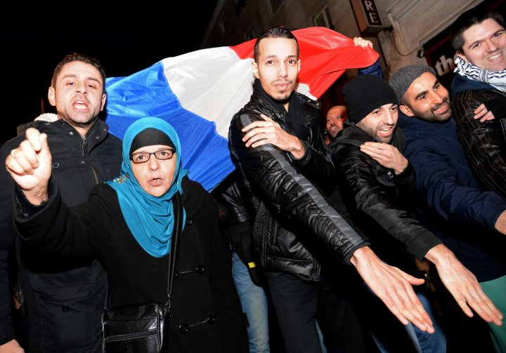 French protesters perform the 'Quenelle' salute, branded anti-Semitic by Jewish groups. (PIERRE ANDRIEU/AFP/Getty Images)
